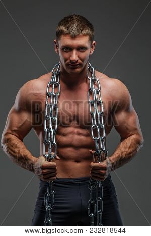 Huge Pumped Male Posing Holding Steel Chain And Showing His Muscules