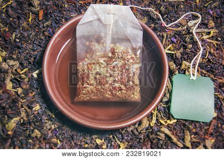 Herbal Tea In A Cup Of Brewed Tea Bag Closeup Composition And Ready Free Space Copyspace On The Labe