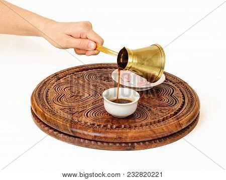She Is Serving A Black Coffee From Turkish Coffee Pot (a Jazve Or An Ibrik), And Pouring It In Turki