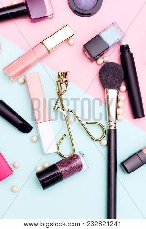 Decorative Cosmetics On A Multi-colored Background. Vertical