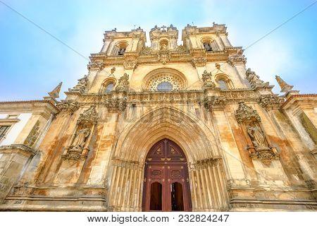 Bottom View Of Main Gate Of Roman Gothic Monastery Of Alcobaca Or Mosteiro De Santa Maria De Alcobac