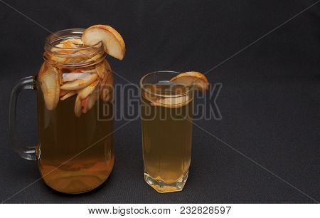 Compote Of Dried Fruits With Dried Fruit On A Black Background.