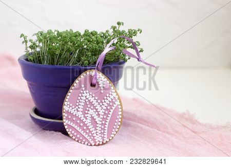 Homemade Gingerbread Easter Lilac And Pink Color In The Form Of Egg With A Floral Pattern. Selective
