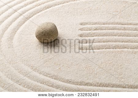Zen Sand And Stone Garden With Raked Lines And Curves With Selective Focus. Simplicity, Concentratio