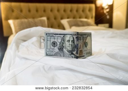 Bed And Money To Symbolize The Cost Of Sex. Paid Love The Prostitute. Payment For The Services Of Pr
