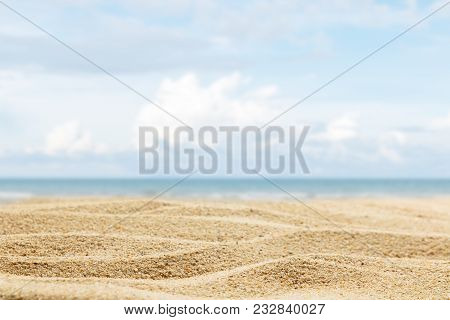 Close Up Sand Of Beach On Blur Beautiful Sky Background, Summer Concept