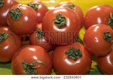 Tomatoes, Tomatoes On A Saucer With Sunflowers. Tomato Juice