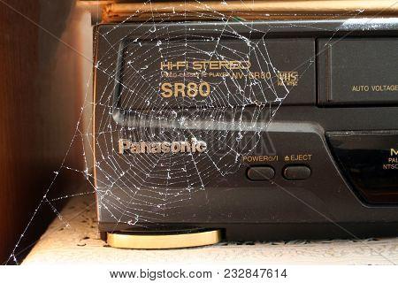Kiev, Ukraine - 27.09.2005. Old Cassette Video Recorder In A Spiderweb
