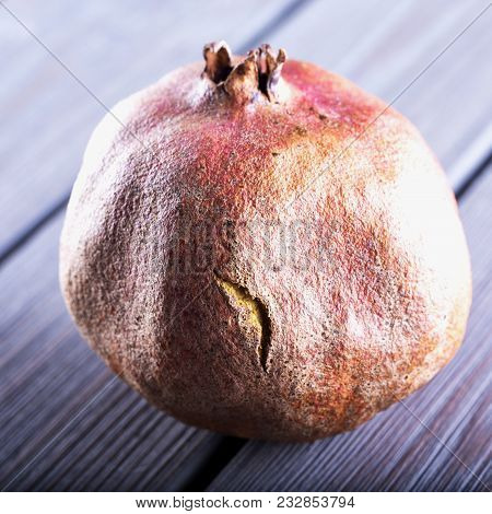 Pomegranate Over Wooden Table