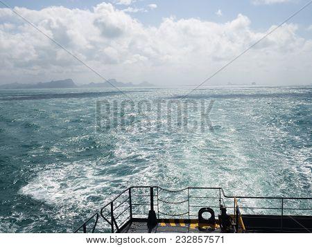 Summer Day Travelling By Ferry Boat Ship. Boat Propeller Wake Foam Water Sea Surface In Wash Blue.