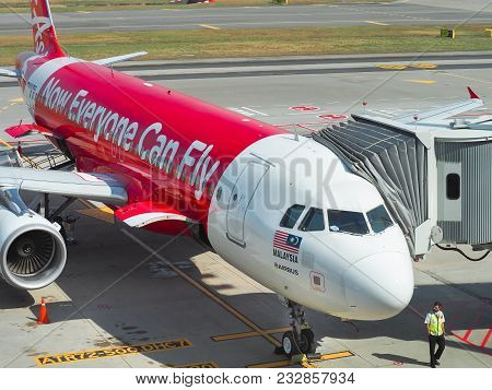 Changi Airport, Singapore. 6th March 2017: Aircraft Of The Air Asia Airline Waiting For Passengers,