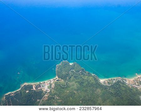Top View Landscape Island Mountain And Coast With Blue Sea Ocean. View From Airplane While Flying Ov