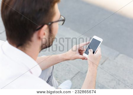 Businessman Texting On Mobile Phone While Sitting On Stone Stairs, Copy Space. Man In Formalwear Wit