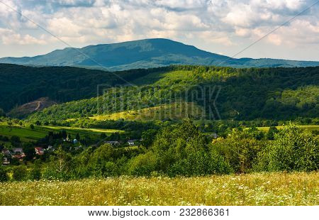 Village In The Valley Of Carpathian Mountains. Beautiful Summer Scenery On A Cloudy Day