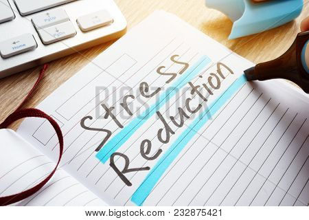 Man Writing Stress Reduction In A Note.