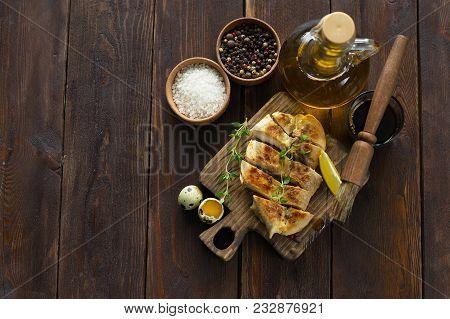 Chicken Breast In Marinade On Wooden Background