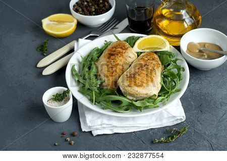 Chicken Breast With Rocket Leaves On Grey Background