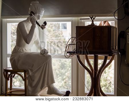Moscow, Russia - March 20, 2018: Sculpture Of Woman Holding Retro Black Telephone Handset And Sittin