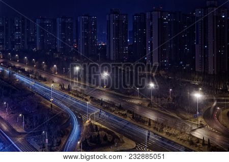 Looking On The Skyscraper In A Row And A Motorway By Night, Shenyang, China