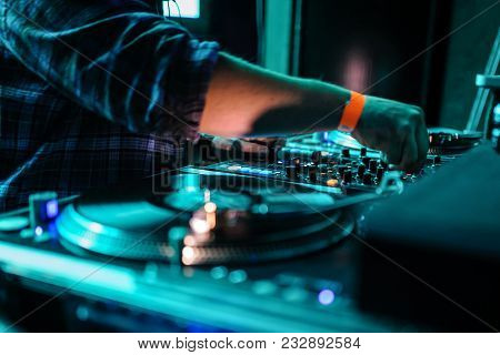 Close Up Of Dj Control Panel Playing Party Music On Modern Player In Disco Club
