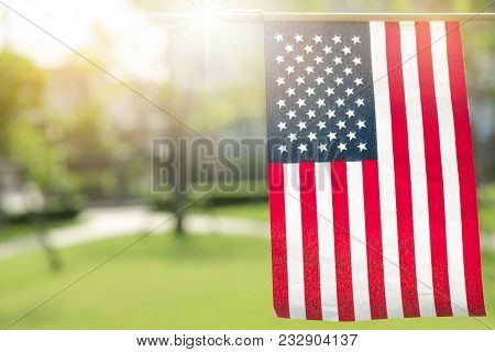American Flag With Bokeh Natural Background And Sunlight For Memorial Day Or 4th Of July.