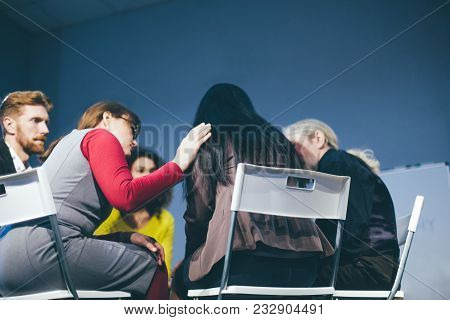 Supportive Group Members Comfort Young Woman. Having Group Therapy. Toned Concept.