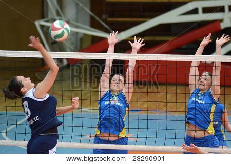 KAPOSVAR, HUNGARY - APRIL 24: Barbara Balajcza (R) blocks the ball at the Hungarian NB I. League woman volleyball game Kaposvar (blue) vs Ujbuda (black), April 24, 2011 in Kaposvar, Hungary.