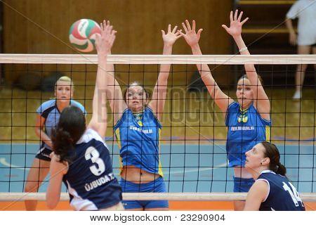 KAPOSVAR, HUNGARY - APRIL 24: Barbara Balajcza (8) blocks the ball at the Hungarian NB I. League woman volleyball game Kaposvar (blue) vs Ujbuda (black), April 24, 2011 in Kaposvar, Hungary.