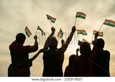 Indian Patriots With Flags Outdoor. Silhouette Of Patriotic Indianfamily, Rear View.