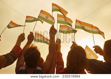 People Holding Small Indian Flags. Rally For Human Rights In India. Patriotic Family Outdoor. Evenin