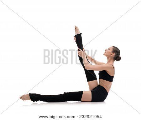 Slim Girl In Black Sportswear Streching Gracefully Isolated Profile Shot On White Background