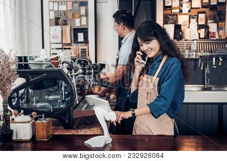 Asia Barista Waiter Use Tablet Take Order From Customer In Coffee Shop,cafe Owner Writing Drink Orde
