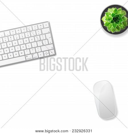 White Office Desk Table With Wireless Aluminum Keyboard, Mouse And Succulent Flower In Pot. Top View