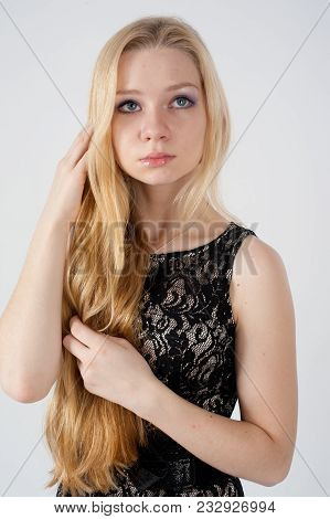 Portrait Of Blond Woman Over White Background