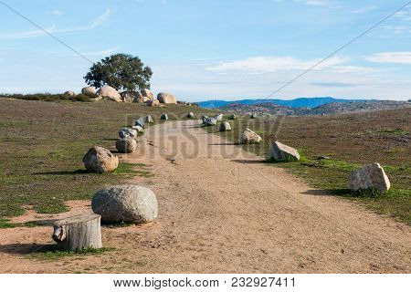 Boulder-lined Trailhead At Ramona Grasslands Preserve In San Diego, California With Mountain Range I