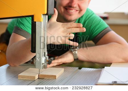 Happy Smiling Worker Wearing Yellow Hard Hat Shows Four Fingers Portrait. Manual Job Workplace Diy I