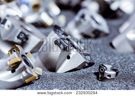 Modern milling cutters for metal on CNC milling machines. Cutter with replaceable inserts. poster