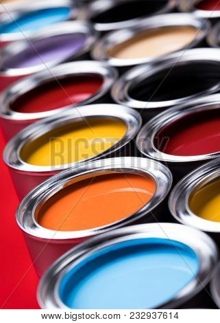 Group of tin metal cans with color paint