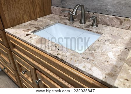 sink in bathroom, rectangular sink with faucet, granite counter with under mount sink, white china sink