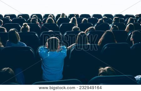 Great Ammount Of People Watching Movie In Big Cinema Hall, Sitting On Comfortable Places. Backview O