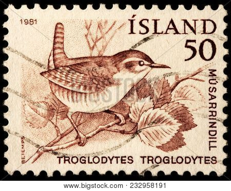 Luga, Russia - January 16, 2018: A Stamp Printed By Iceland Shows Eurasian Wren - A Very Small Bird,