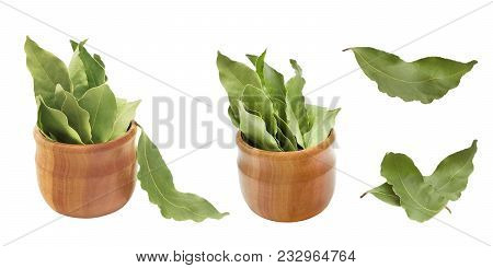 Set Of Dried Aromatic Bay Leaves In A Wooden Bowl Isolated On White. Photo Of Laurel Bay Harvest For