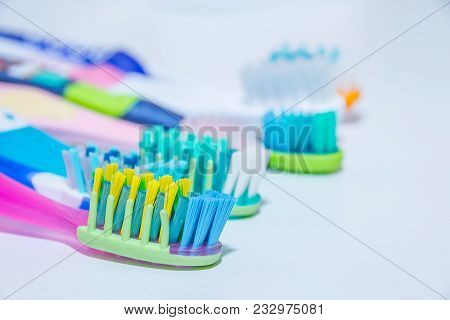 Whitening. Tooth Care. Teeth Healthy Concept. New Ultra Soft Toothbrushes In A Row, Dental Industry.