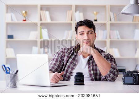 Young photographer sitting at the desk