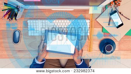 Digital composite of Digitally generated image of businessman holding tablet PC