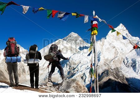View Of Mount Everest With Tourists And Buddhist Prayer Flags From Kala Patthar And Blue Sky - Way T