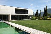 beautiful modern house outdoors, pool view poster