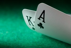 Two Playing Cards On Green Cloth Playing Pocker