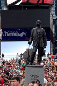 New York, Usa - Aug 17, 2016: George M Cohan Statue Place In Times Square, Background With Neon Adve