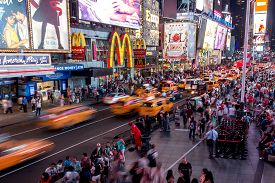 New York City, Usa - Aug 17, 2016: Cars And Crowded Moving Around Times Square, Nyc At Nighttime, Ba